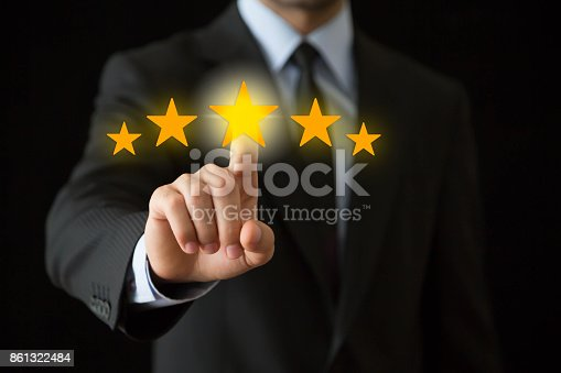 Businessman touchscreen gold stars