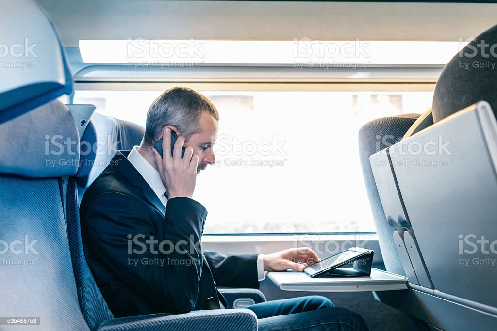Businessman train travelers stock photo
