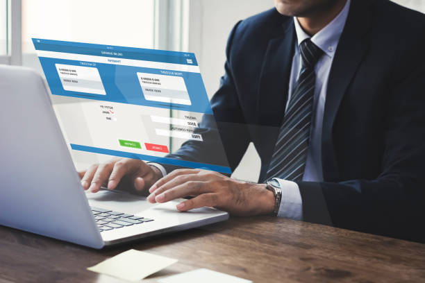 businessman transferring money with internet online e-banking on laptop computer - electronic banking stock pictures, royalty-free photos & images