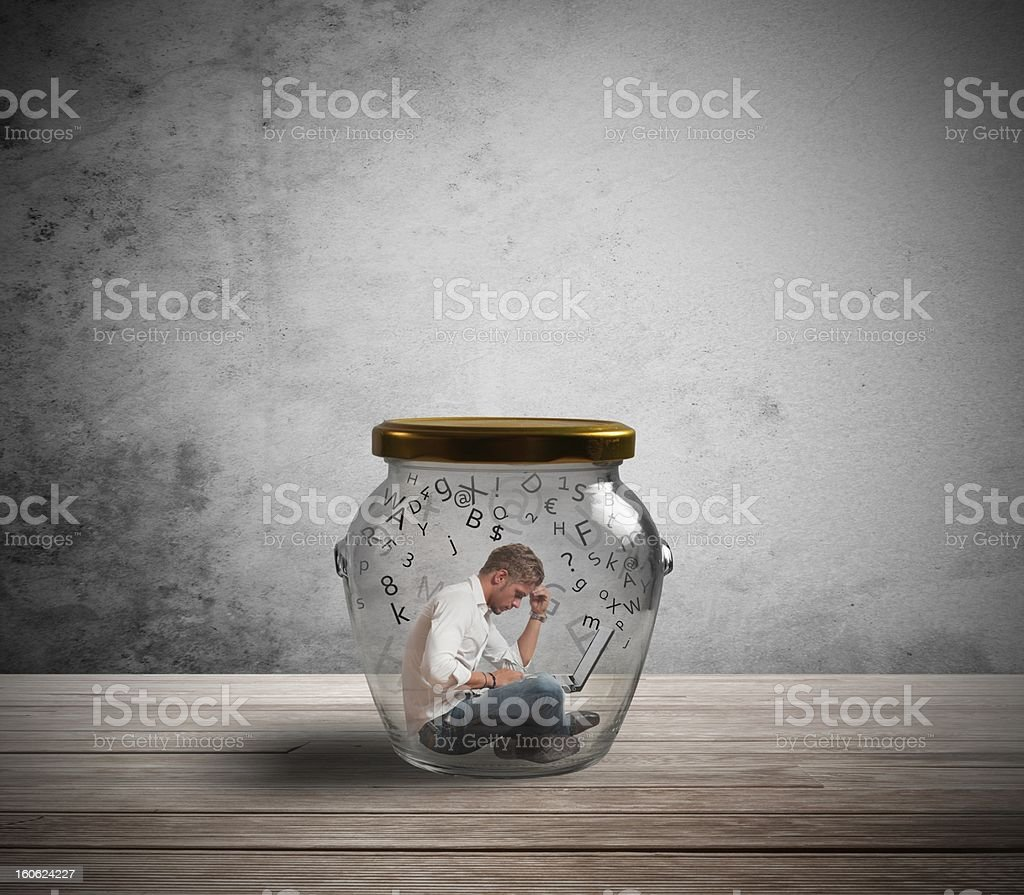 Businessman trapped by work stock photo