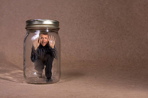 Businessman trapped in jar (Concept Series)  trap stock pictures, royalty-free photos & images