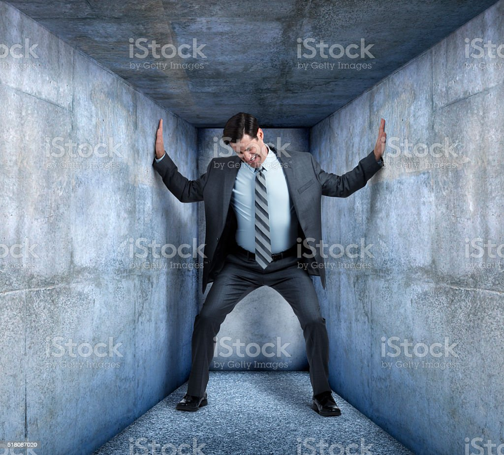 Businessman Trapped In Small Space stock photo