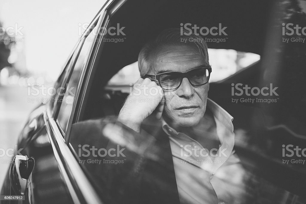 Businessman traveling by taxi stock photo