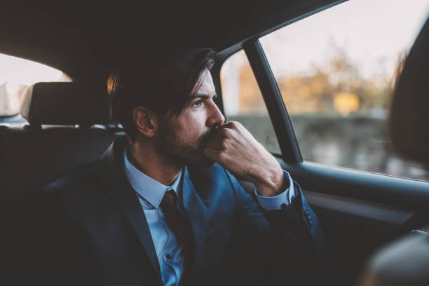 Businessman traveling in taxi stock photo