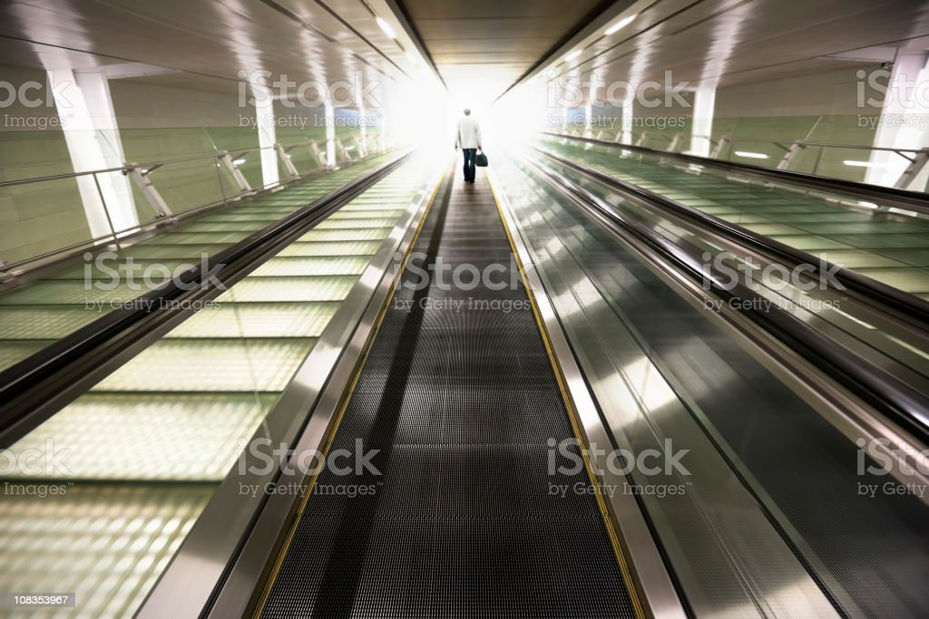 Businessman travelling into the light. royalty-free stock photo