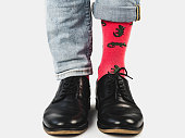 istock Businessman, trendy shoes, jeans and bright socks 1131453145