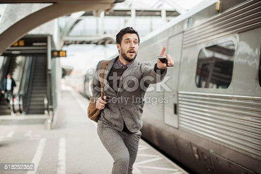 Photo of a businessman trying to catch the train