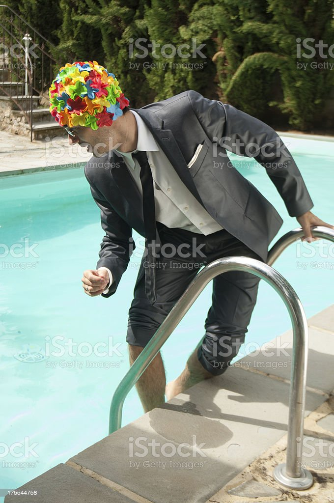 Businessman Trying to enter in a Swimming Pool stock photo