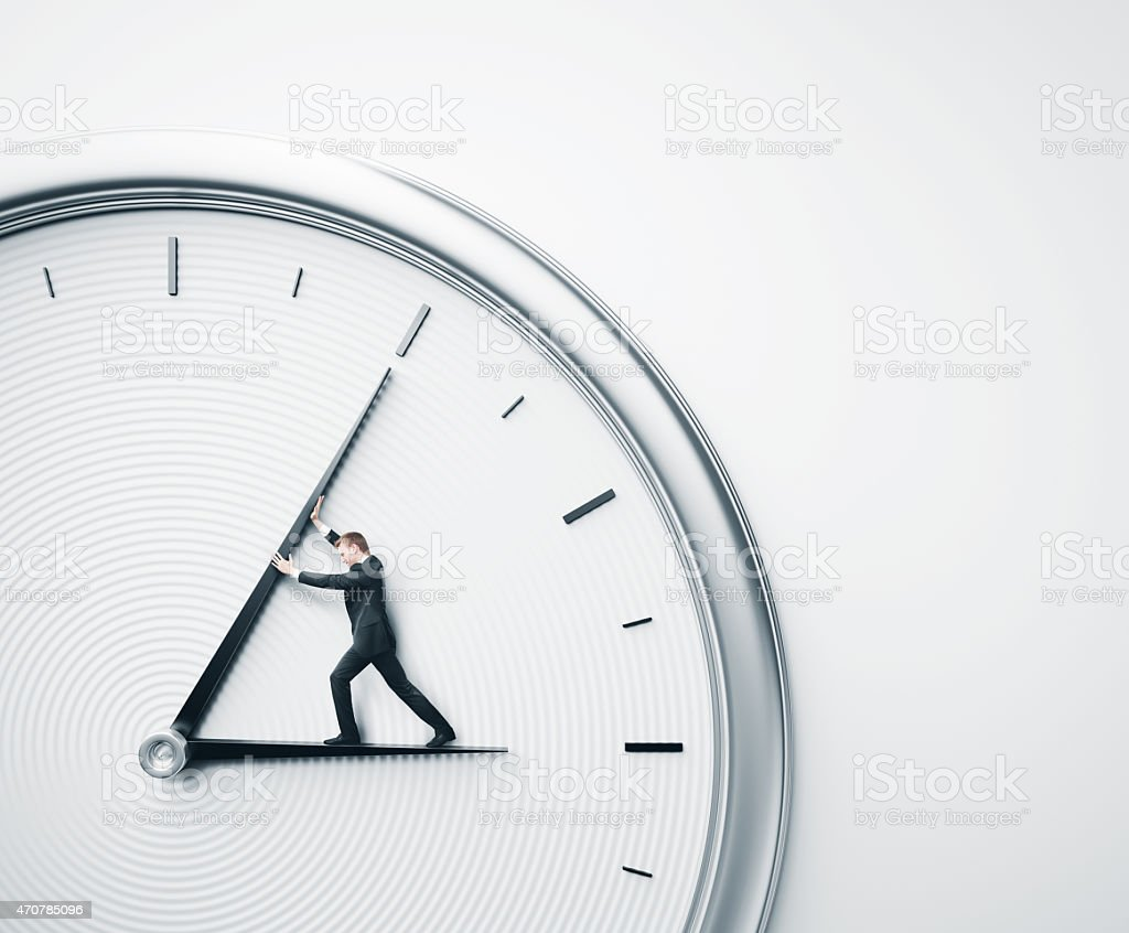 Businessman trying to stop time stock photo