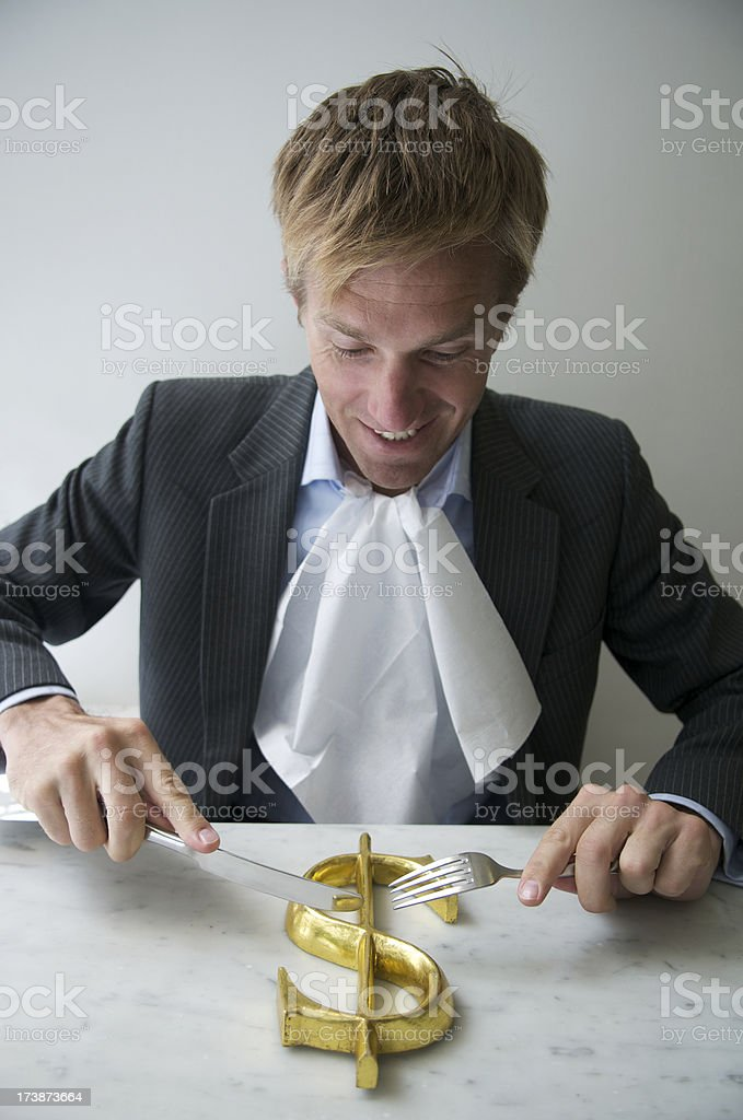 Businessman Tucks Into a Golden Dollar royalty-free stock photo