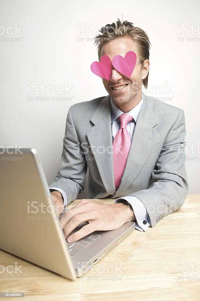 Businessman Types w Hearts in his Eyes royalty-free stock photo