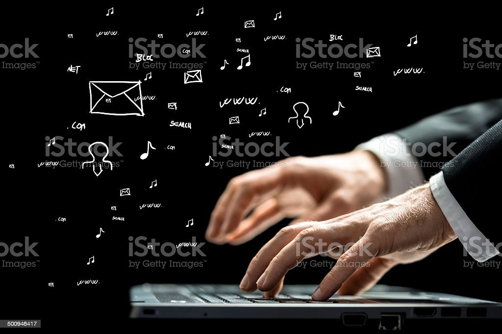 Businessman typing on a computer keyboard stock photo
