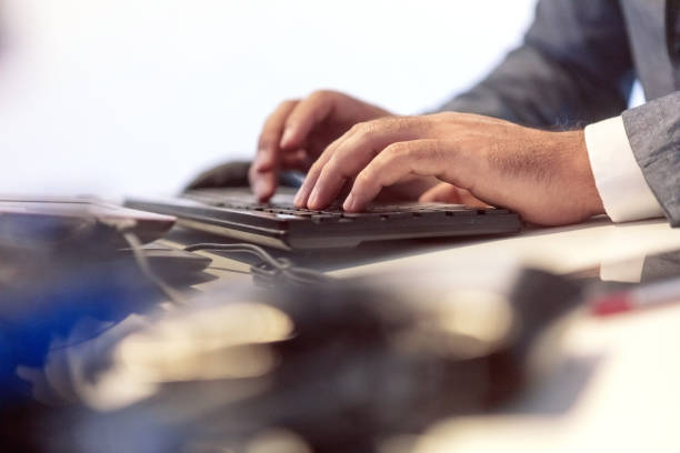 Businessman typing on computer keyboard stock photo