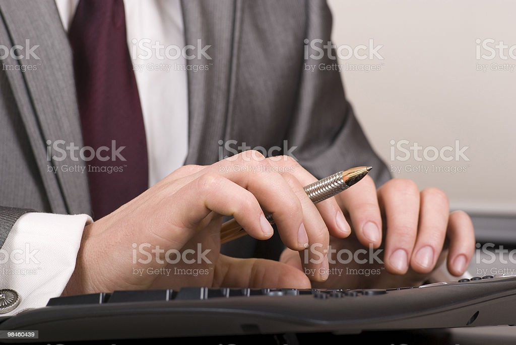 Businessman typing on computer keyboard royalty-free stock photo