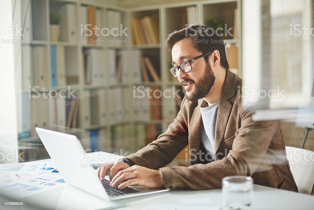 Businessman typing stock photo