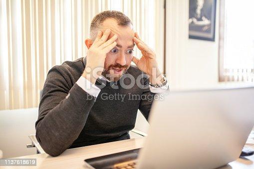 istock Businessman under pressure in the office 1137618619
