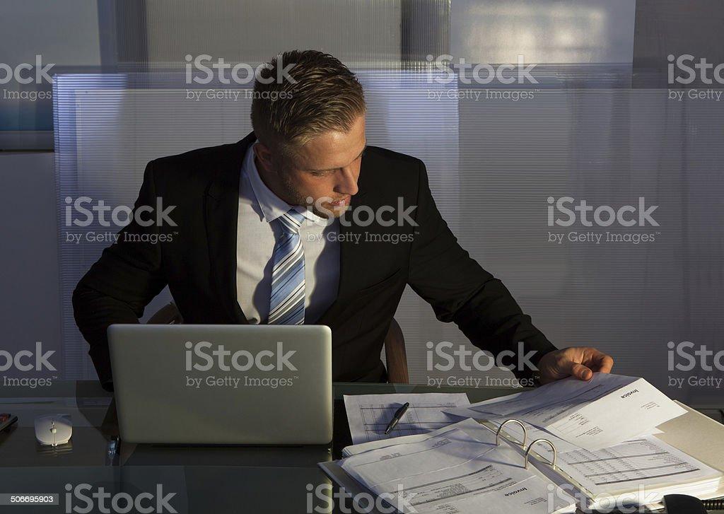 Businessman under pressure working overtime stock photo