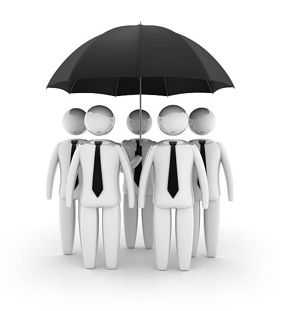 Businessman under umbrella stock photo