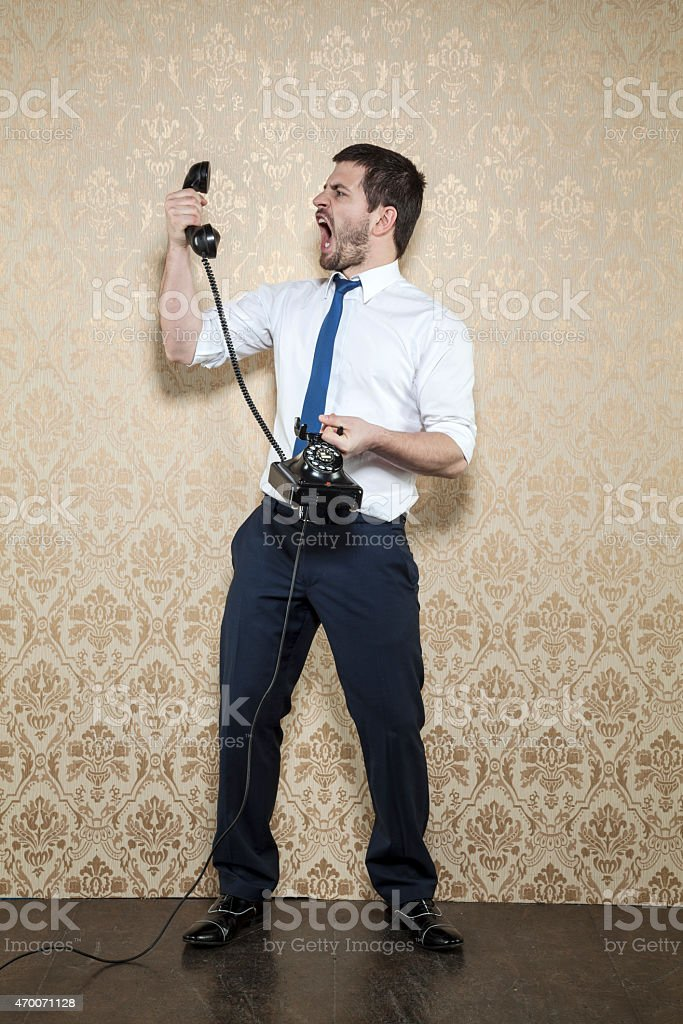businessman unloads anger during a conversation stock photo