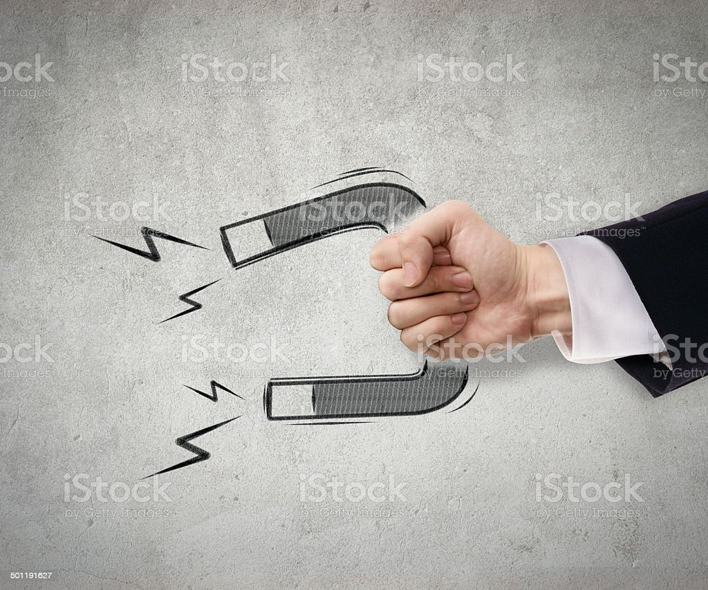 Businessman use magnet to attract stock photo