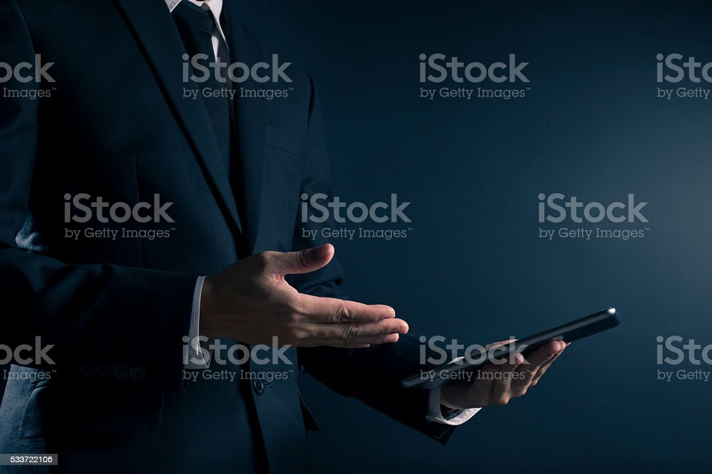 Businessman Use Tablet on Isolated  Background stock photo