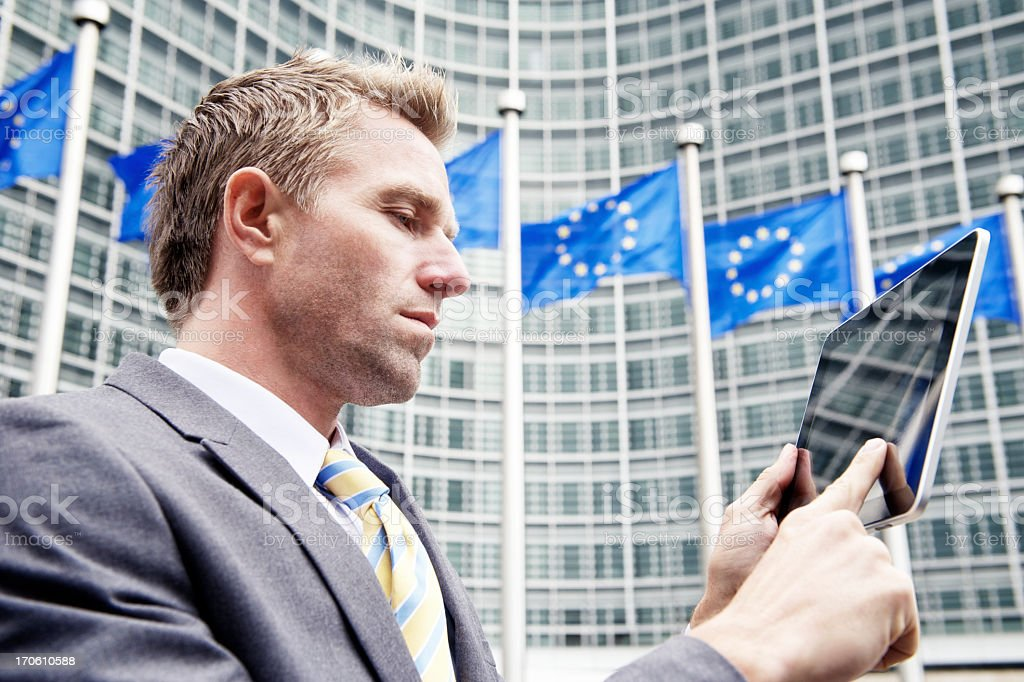 Businessman Uses Digital Tablet Computer at European Commission Brussels royalty-free stock photo