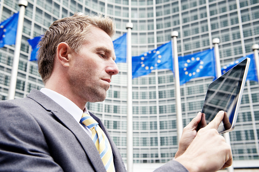 Businessman Uses Digital Tablet Computer At European Commission Brussels Stock Photo - Download Image Now
