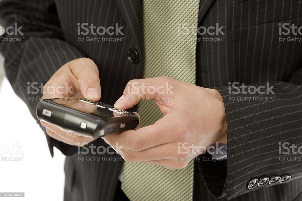 Businessman uses PDA royalty-free stock photo