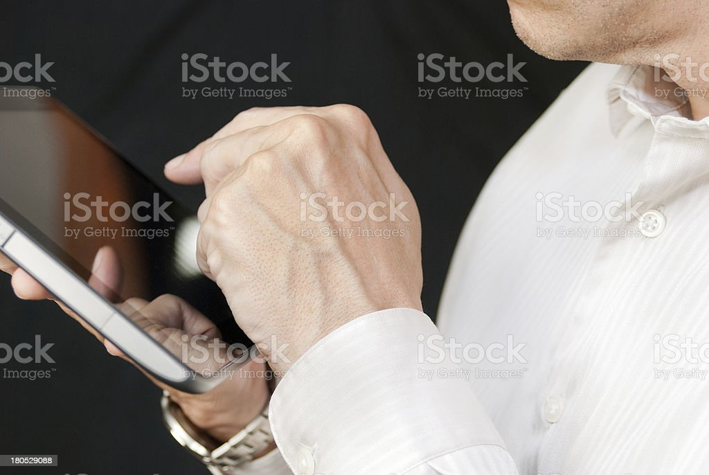 Businessman Uses Tablet, Close Side royalty-free stock photo