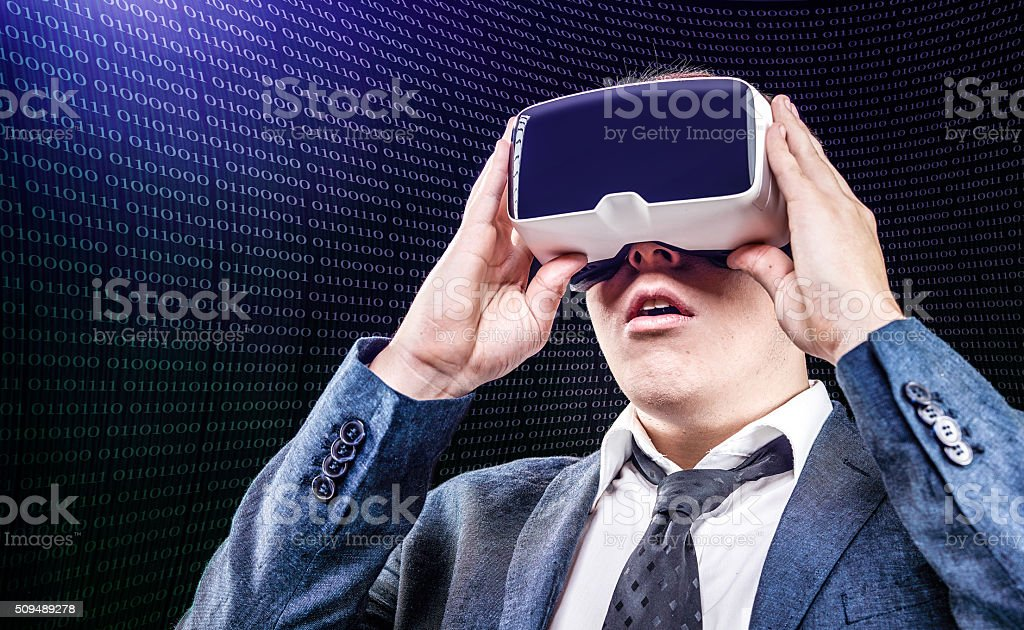 Businessman uses Virtual Reality VR head mounted display stock photo