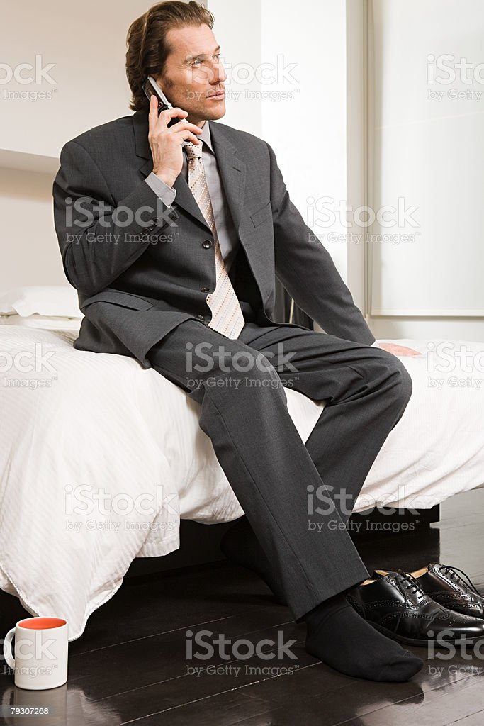 A businessman using a cellular telephone royalty-free stock photo