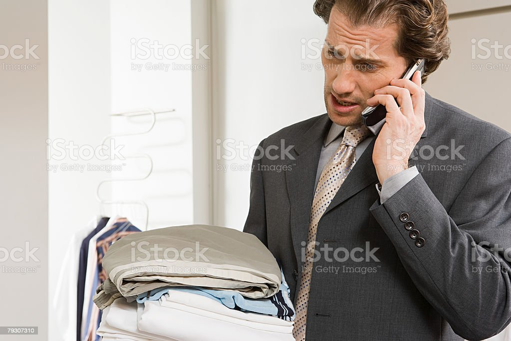 A businessman using a cellular telephone 免版稅 stock photo