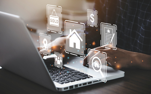 Businessman using a computer for property sales & listings, realtor agency & contractor, residential property, investment, housing project, property development real estate, choose a house buy online.