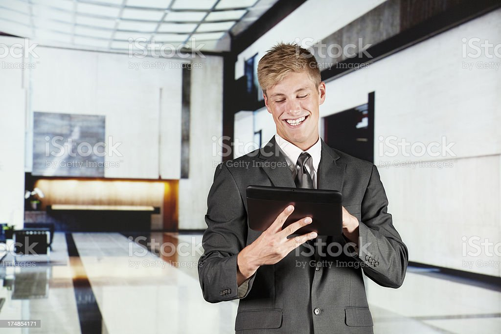 Businessman using a digital tablet in office stock photo