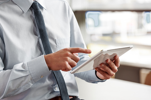 Businessman Using A Digital Tablet In The Office Stock Photo - Download Image Now