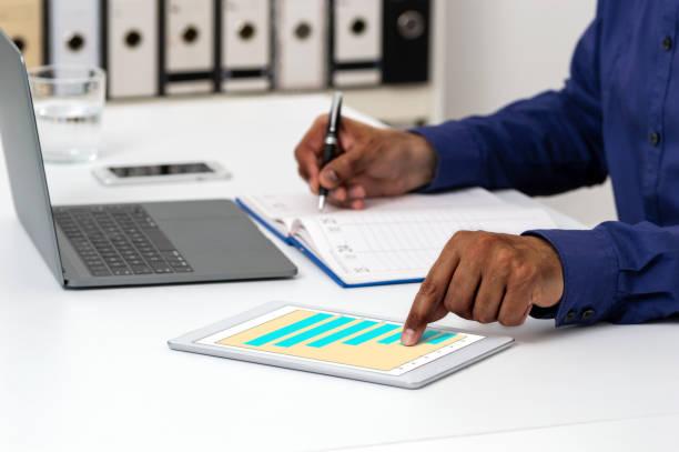businessman using a digital tablet stock photo
