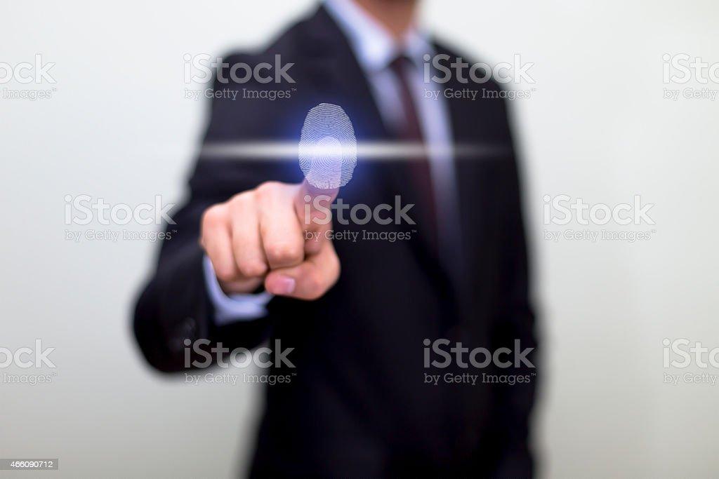 Businessman using a fingerprint sensor stock photo
