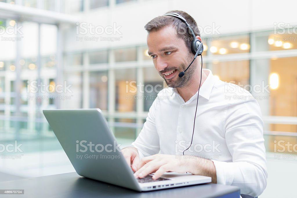 Businessman using a head set stock photo