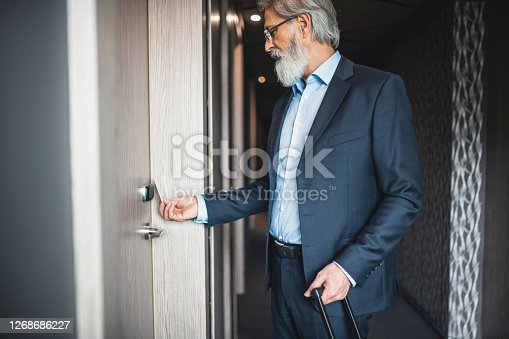 Businessman using a keyless entry card to enter his hotel room