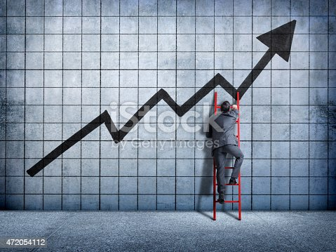 istock Businessman using a ladder in search of success 472054112