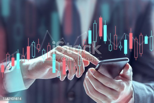 826058232istockphoto Businessman using a mobile phone to check stock market data, Technical price graph and indicator, Double exposure. 1182101614