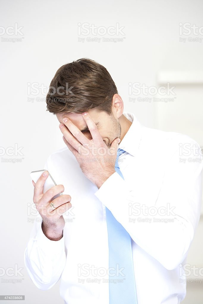 Businessman using a mobile telephone royalty-free stock photo