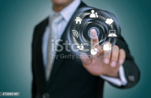 istock Businessman using a modern interface 470062487