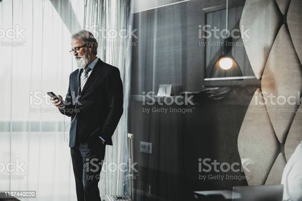Businessman using a phone in hotel room picture id1137440220?b=1&k=6&m=1137440220&s=612x612&h=hzdb08ht4qgov6sjmrvw2ujhnj9fxvewsd3bn pqeq8=