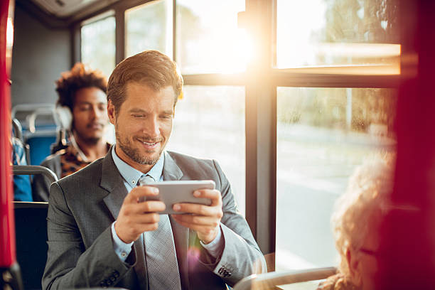 businessman using a phone - mobile game stock photos and pictures