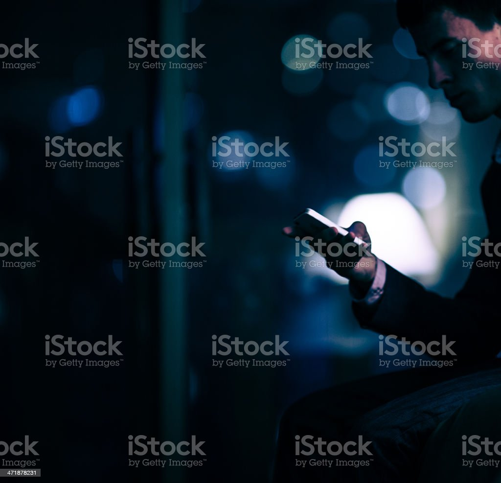 Businessman using a smartphone royalty-free stock photo
