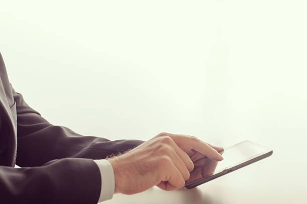 Businessman using a tablet device stock photo