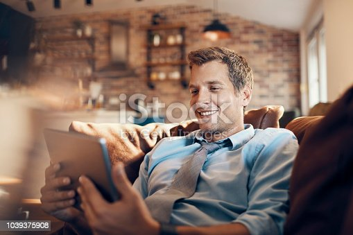 Close up of a businessman using his tablet at home