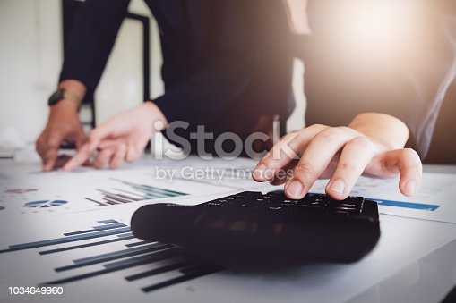 1032388356 istock photo Businessman using calculator  are meeting to plan sales to meet targets set in next year. audit budget and financial concept 1034649960
