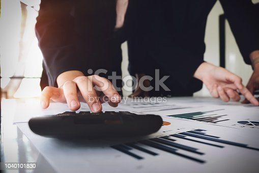 1032388356 istock photo Businessman using calculator  are meeting to plan sales to meet targets set in next year. audit budget and financial concept 1040101830